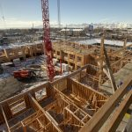Construction workers work at the Garden Lofts, an affordable housing project being built in Salt Lake City, on Friday, Dec. 28, 2018.