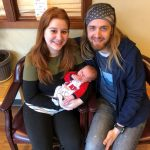 Nicole and Daniel Fahrnkopf hold their new baby Judah in Port Orchard. Nicole was unable to bank comp time because her supervisors said she couldn